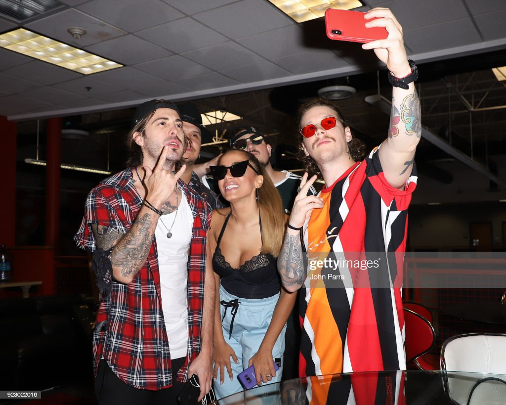 Juan David M. Castano, Juan David Huertas Clavijo, Pablo Mejia Bermudez ,David Escobar Gallego of Piso21 and Anitta (C) visit The Enrique Santos Show At I Heart Latino Studio on February 21, 2018 in Miramar, Florida.