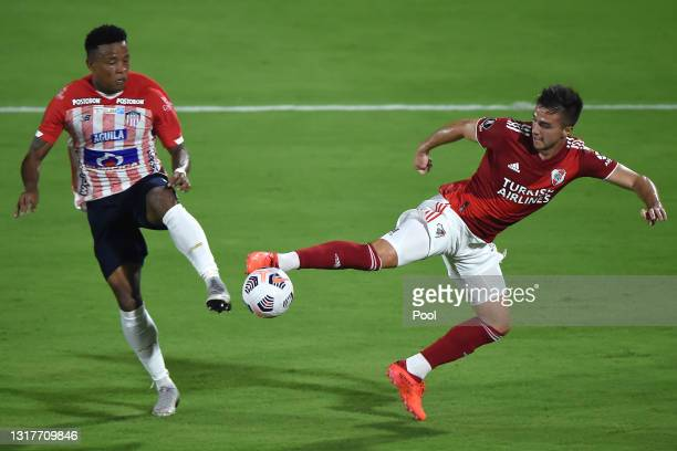 Juan David Rodríguez of Junior competes for the ball with Agustín Palavecino of River Plate during a match between Junior and River Plate as part of...