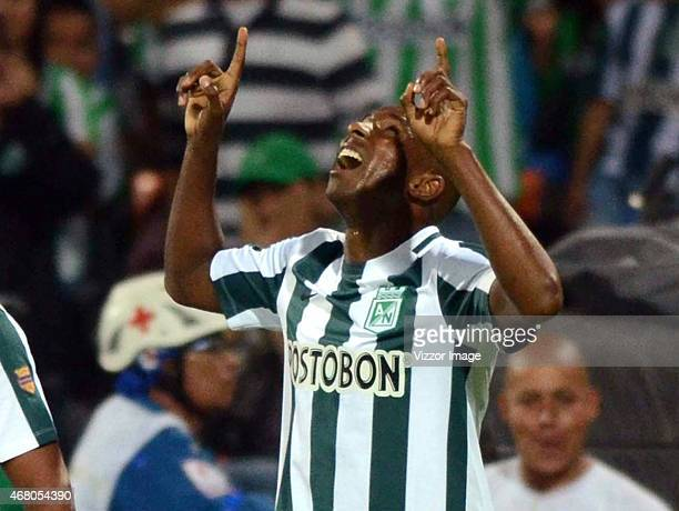 Juan David Valencia player of Atletico Nacional celebrates with his teammates after scoring a goal against Deportes Tolima during a match between...