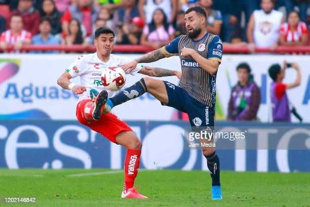 Juan Delgado of Necaxa fights for the ball with Luis Gallegos of San Luis during the 3rd round match between Necaxa and Atletico San Luis as part of...