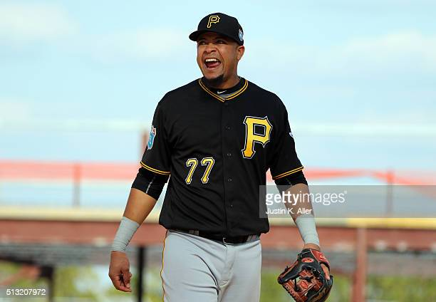 Juan Diaz of the Pittsburgh Pirates sings between inning during the game against the Detroit Tigers at Joker Marchant Stadium on March 1 2016 in...