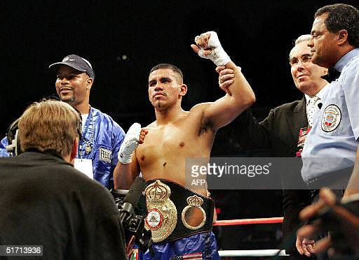 Juan Diaz of the US is declared winner after defeating Julien Lorcy of France during their World Boxing Association lightweight title bout at the SBC...