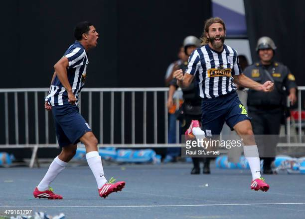 Juan Diego Gonzales Vigil of Alianza Lima celebrates a scored goal against Sporting Cristal during a match between Sporting Cristal and Alianza Lima...