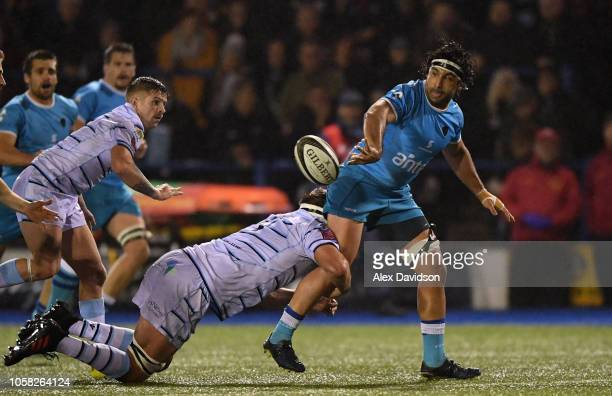 Juan Diego Ormaechea of Uruguay passes as he is tackled by James Down of Cardiff Blues during the Syft International Challenge game between Cardiff...