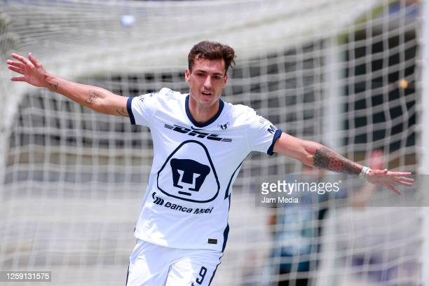 Juan Dinenno of Pumas celebrates after scoring the first goal of his team during the 1st round match between Pumas UNAM and Queretaro as part of the...