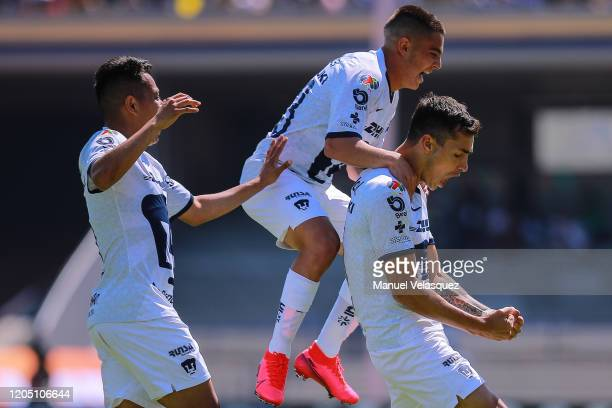 Juan Dinenno of Pumas celebrates after scoring the third goal of his team with his teammates during the 5th round match between Pumas UNAM and...