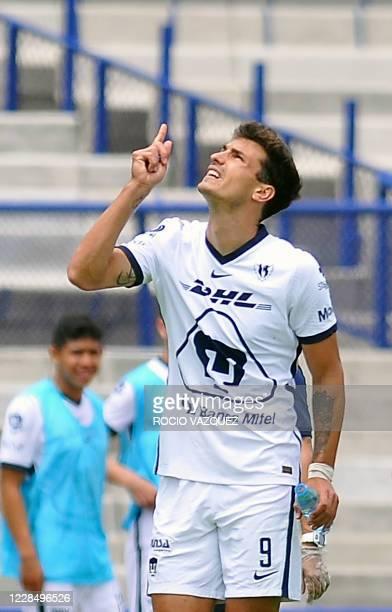 Juan Dinenno of Pumas celebrates his goal against Atletico de San Luis during Mexico's Liga MX Apertura tournament football match between Pumas and...