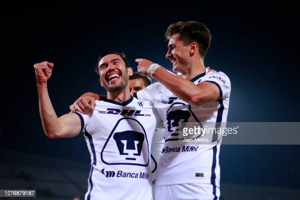 Juan Dinenno of Pumas celebrates with Andres Iniestra after scoring the first goal of his team during the 12th round match between Pumas UNAM and...