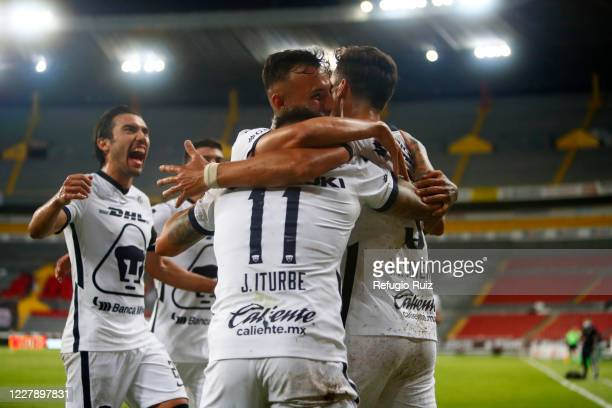 Juan Dinenno of Pumas celebrates with teammates after scoring the second goal of his team during the 2nd round match between Atlas and Pumas UNAM as...
