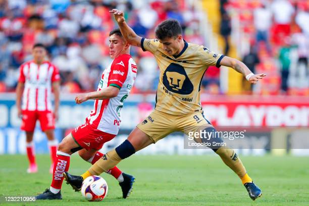 Juan Dinenno of Pumas UNAM competes for the ball with Alejandro Zendejas of Necaxa during the 14th round match between Necaxa and Pumas UNAM as part...