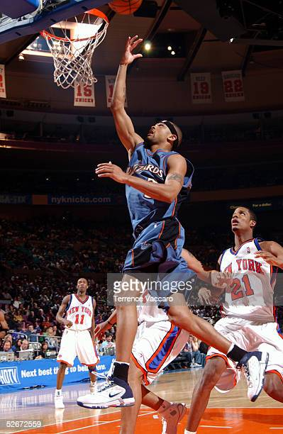 Juan Dixon of the Washington Wizards drives to the hoop past Trevor Ariza of the New York Knicks on April 20 2005 at Madison Square Garden in New...