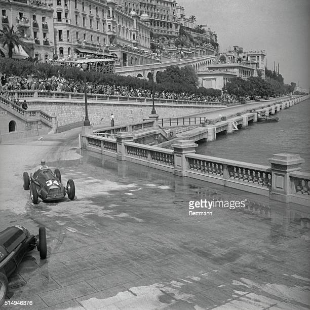 Juan Emmanuel Fangio of Argentina skillfully maneuvers his Alfa Romeo car, May 21, to take the Grand Prix of Monaco. He covered the allotted track in...