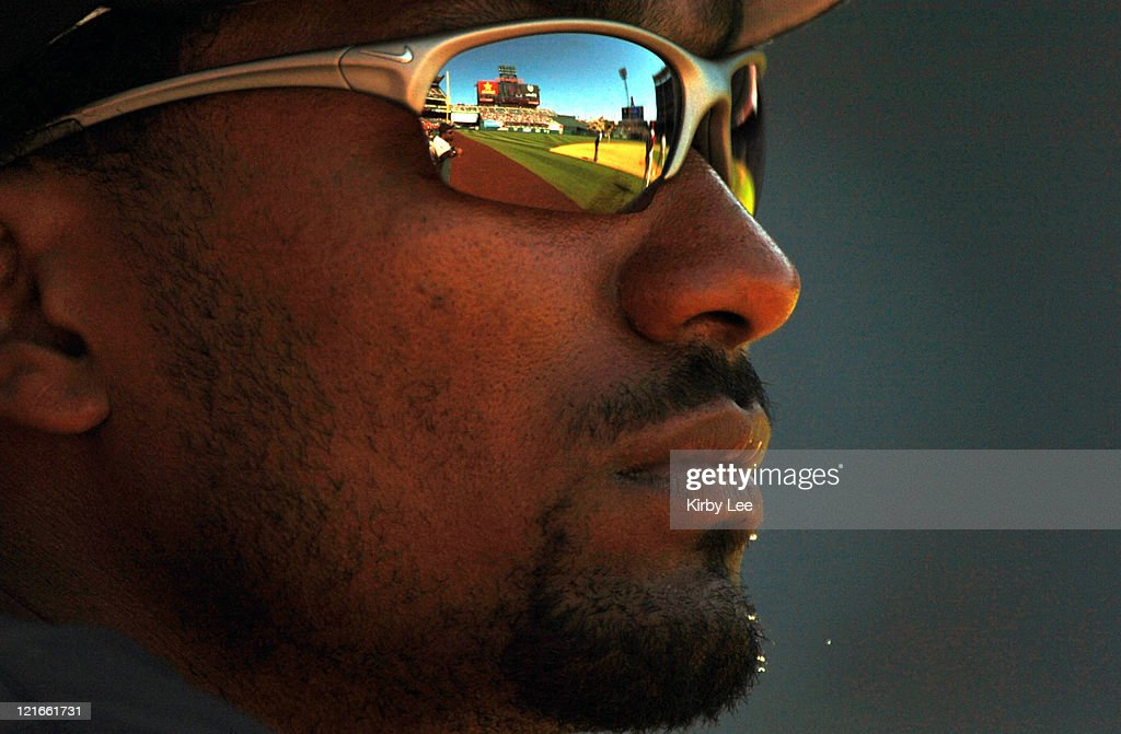 Juan Encarnacion of the Florida Marlins watches during 7-5 victory over the Los Angeles Angels of Anaheim with relection of Angel Stadium in Nike sunglasses in the game at Angel Stadium in Anaheim, California on Sunday, June 19, 2005.