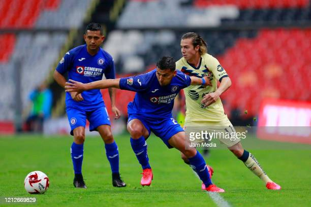 Juan Escobar of Cruz Azul fights for the ball with Francisco Cordova of America during the 10th round match between America and Cruz Azul as part of...