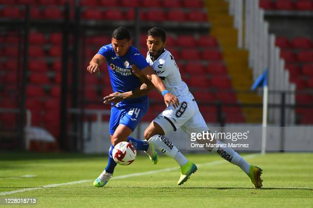 Juan Escobar of Cruz Azul fights for the ball with Kevin Ramirez of Queretaro during the 4th round match between Queretaro and Cruz Azul as part of...