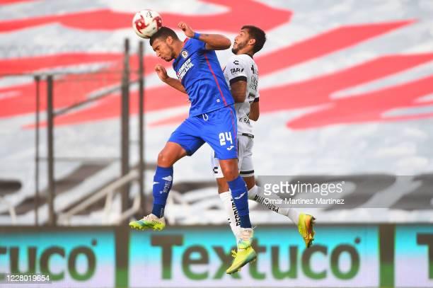 Juan Escobar of Cruz Azul jumps for the ball with Kevin Ramirez of Queretaro during the 4th round match between Queretaro and Cruz Azul as part of...