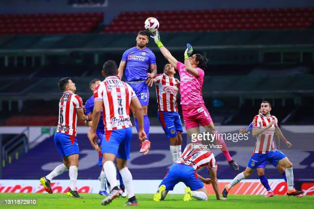 Juan Escobar of Cruz Azul struggles for the ball against Jose Rodriguez of Chivas during the 14th round match between Cruz Azul and Chivas as part of...