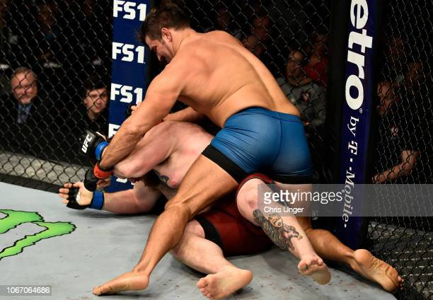 Juan Espino of Spain punches Justin Frazier during The Ultimate Fighter Finale event inside The Pearl concert theater at Palms Casino Resort on...