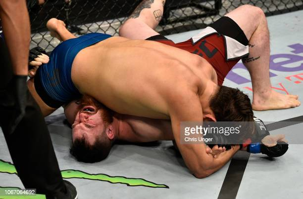 Juan Espino of Spain secures an arm bar submission against Justin Frazier during The Ultimate Fighter Finale event inside The Pearl concert theater...