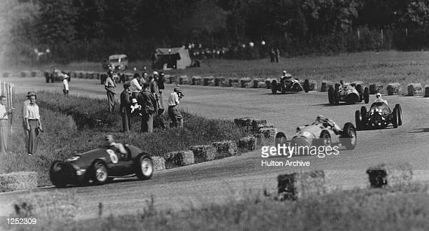 Juan Fangio leads out the Italian Grand Prix at Monza Mandatory Credit: Allsport Hulton/Archive