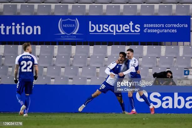 Juan Fernandez 'Ibiza' of CE Sabadell FC celebrates his teammate Juan Hernandez after scoring his team's first goalduring the LaLiga SmartBank match...
