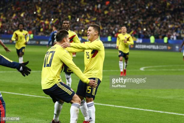 Juan Fernando Quintero and James Rodriguez during the friendly football match between France and Colombia at the Stade de France in SaintDenis on the...