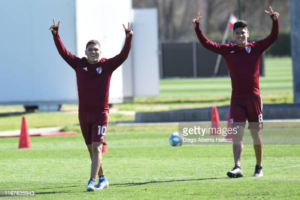 Juan Fernando Quintero and Jorge Carrascal gesture during River Plate's training session at River Camp on September 12 2019 in Ezeiza Argentina