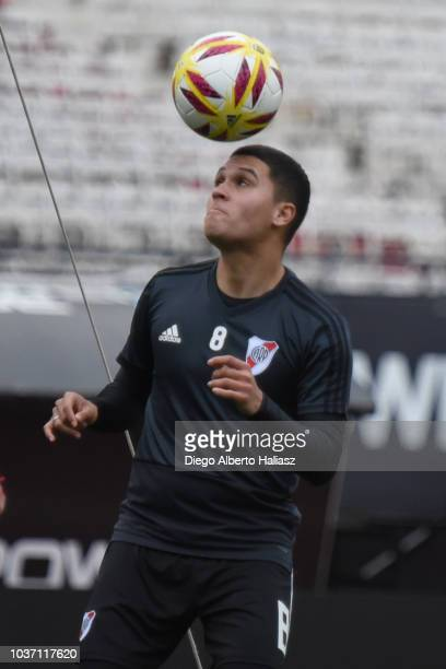 Juan Fernando Quintero heads the ball during a River Plate training session at Estadio Monumental Antonio Vespucio Liberti on September 14 2018 in...