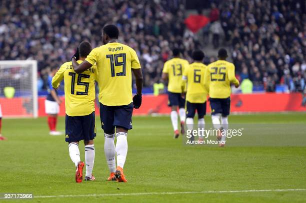 Juan Fernando Quintero of Colombia is congratulated by teammate Duvan Zapata after scoring during the international friendly match between France and...