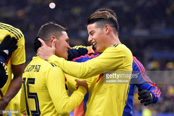 Juan Fernando Quintero of Colombia is congratulated by teammate James Rodriguez after scoring during the international friendly match between France...