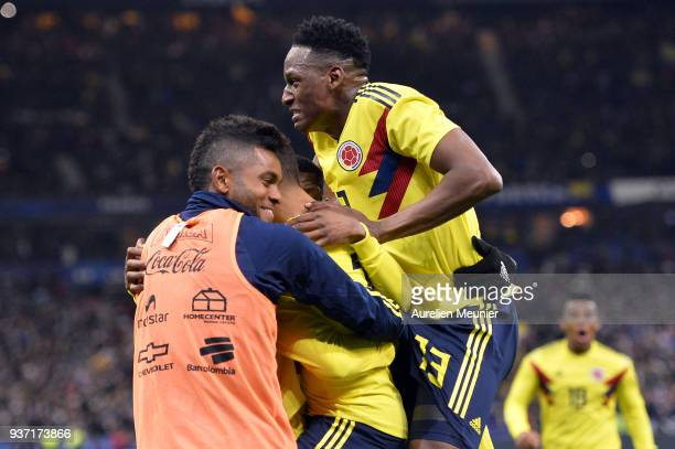 Juan Fernando Quintero of Colombia is congratulated by teammate Yerry Mina after scoring during the international friendly match between France and...
