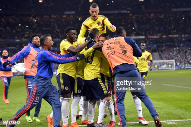 Juan Fernando Quintero of Colombia is congratulated by teammates after scoring during the international friendly match between France and Colombia at...