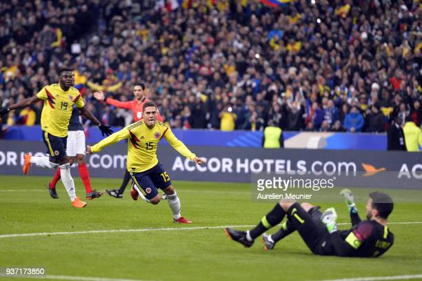 Juan Fernando Quintero of Colombia reacts after scoring on a penalty kick during the international friendly match between France and Colombia at...