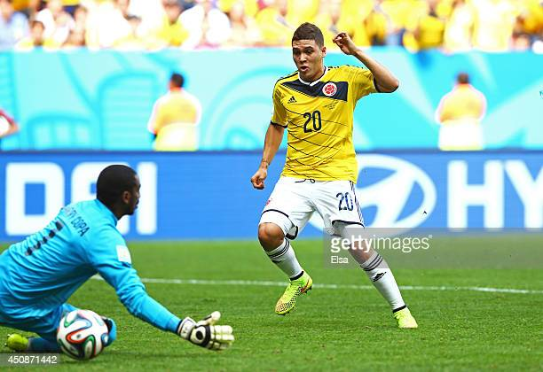 Juan Fernando Quintero of Colombia scores his team's second goal past Boubacar Barry of the Ivory Coast during the 2014 FIFA World Cup Brazil Group C...