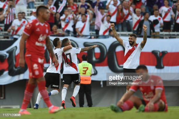Juan Fernando Quintero of River Plate celebrates with teammates after scoring the first goal of his team during a match between River Plate and San...