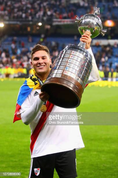 Juan Fernando Quintero of River Plate celebrates with the Copa Libertadores trophy after the second leg of the final match of Copa CONMEBOL...