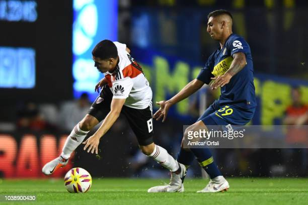 Juan Fernando Quintero of River Plate fights for the ball with Agustin Almendra of Boca Juniors during a match between Boca Juniors and River Plate...