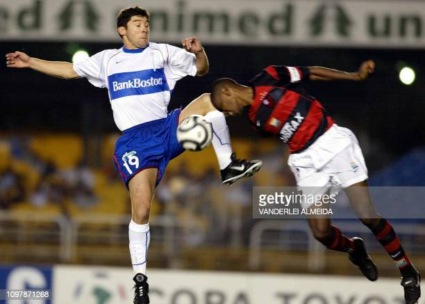 Juan fo the Flamengo de Rio team fights for the ball with chilean Norambuena of Universidad Catolica de Chile during the Copa Libertadores de America...