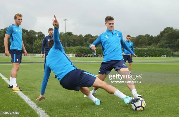 Juan Foyth and Harry Winks of Tottenham during the Tottenham Hotspur training session at Tottenham Hotspur Training Centre on September 7 2017 in...