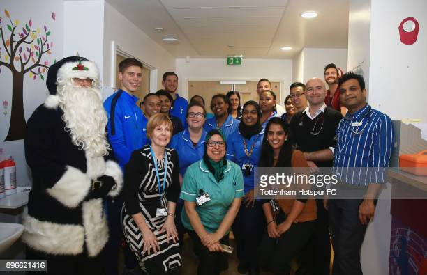 Juan Foyth Bianca Baptiste Jan Vertonghen and Toby Alderweireld pose with staff during a Tottenham Hotspur player visit at North Middlesex Hospital...