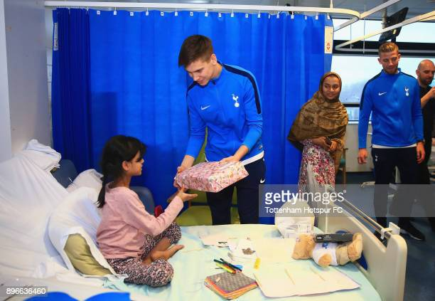 Juan Foyth meets a young patient during a Tottenham Hotspur player visit at North Middlesex Hospital on December 21 2017 in London England
