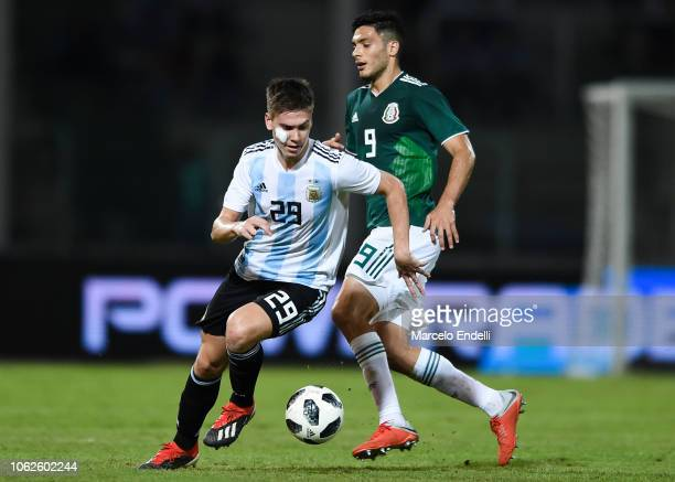 Juan Foyth of Argentina fights for the ball with Raul Jimenez of Mexico during a friendly match between Argentina and Mexico at Mario Kempes Stadium...