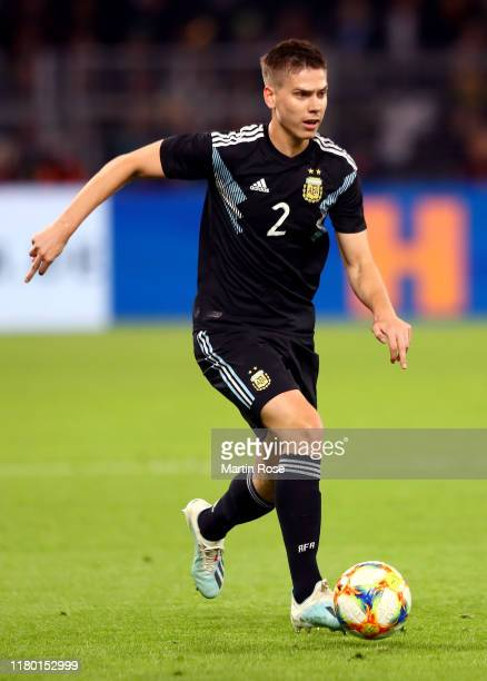 Juan Foyth of Argentina runs with the ball during the International Friendly between Germany and Argentina at Signal Iduna Park on October 09, 2019...