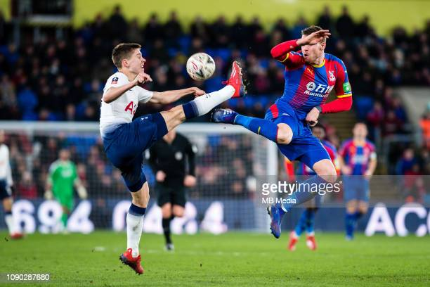 Juan Foyth of Tottenham Hotspur and Connor Wickham of Crystal Palace during the FA Cup Fourth Round match between Crystal Palace and Tottenham...