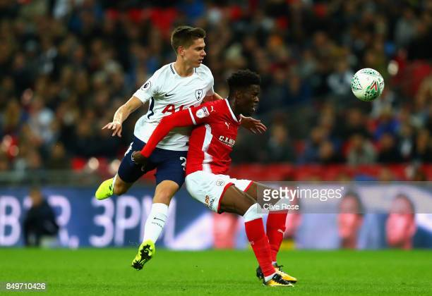 Juan Foyth of Tottenham Hotspur and Ike Ugbo of Barnsley battle for possession during the Carabao Cup Third Round match between Tottenham Hotspur and...