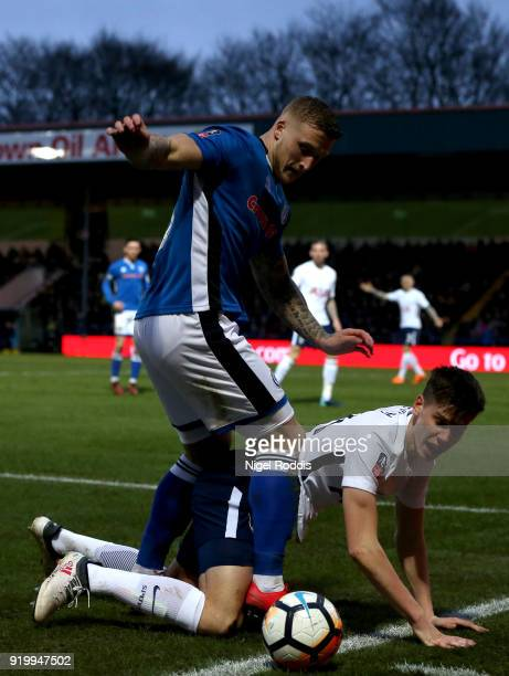 Juan Foyth of Tottenham Hotspur and Jordan Slew of Rochdale AFC during The Emirates FA Cup Fifth Round match between Rochdale and Tottenham Hotspur...