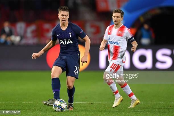 Juan Foyth of Tottenham Hotspur and Marko Marin of Crvena Zvezda during the UEFA Champions League group B match between Crvena Zvezda and Tottenham...