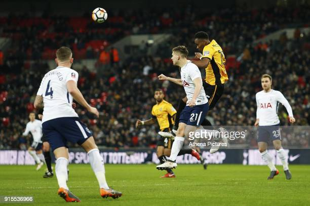 Juan Foyth of Tottenham Hotspur and Shawn McCoulsky of Newport County contend for the aerial ball during the Fly Emirates FA Cup Fourth Round Replay...
