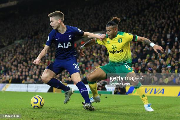 Juan Foyth of Tottenham Hotspur battles for possession with Onel Hernandez of Norwich City during the Premier League match between Norwich City and...