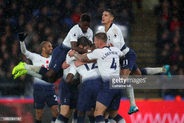 Juan Foyth of Tottenham Hotspur celebrates with his team mates after scoring his team's first goal during the Premier League match between Crystal...